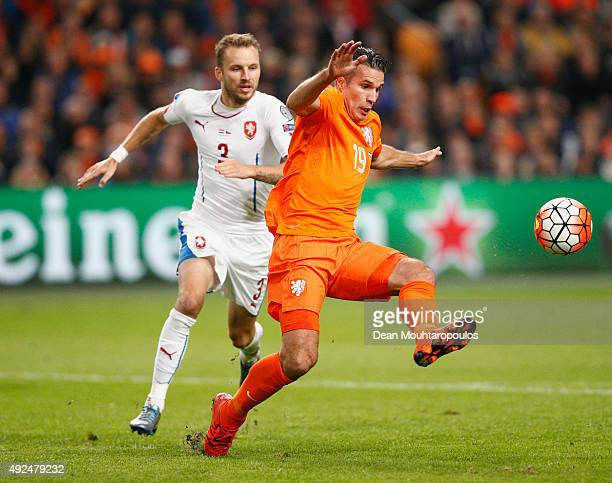 Robin van Persie of the Netherlands shields the ball from Michal Kadlec of the Czech Republic during the UEFA EURO 2016 qualifying Group A match...