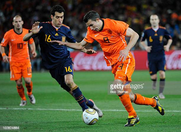 Robin Van Persie of the Netherlands with Sergio Busquets of Spain during the 2010 FIFA World Cup Final between the Netherlands and Spain on July 11...