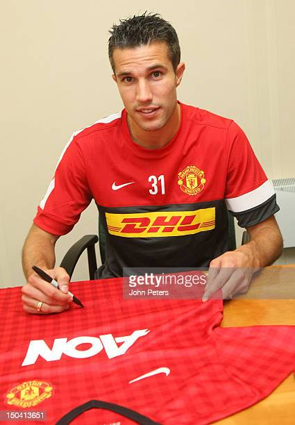 Robin van Persie poses as he signs for Manchester United FC at their Carrington Training Ground on August 17 2012 in Manchester England