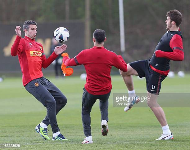 Robin van Persie, Ryan Giggs and Michael Carrick of Manchester United in actoin during a first team training session at Carrington Training Ground on...