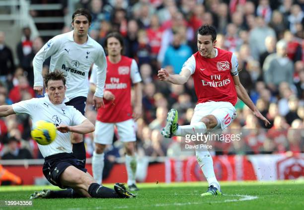 Robin van Persie scores Arsenal's 2nd goal under pressure from Scott Parker of Tottenham during the Barclays Premier League match between Arsenal and...