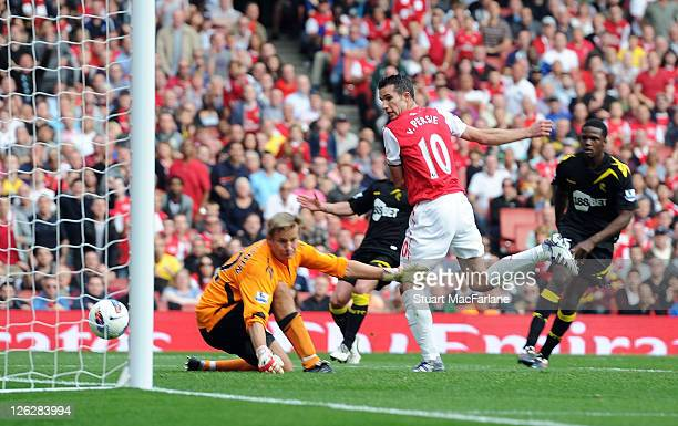 Robin van Persie scores his 2nd goal of the game and his 100th for Arsenal during the Barclays Premier League match between Arsenal and Bolton...