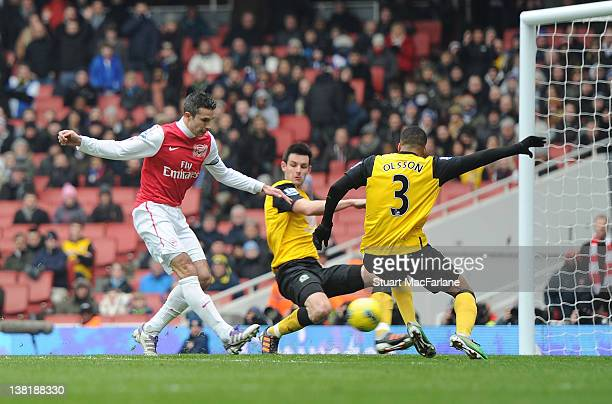 Robin van Persie scores his and Arsenal's 2nd goal during the Barclays Premier League match between Arsenal and Blackburn Rovers at Emirates Stadium...