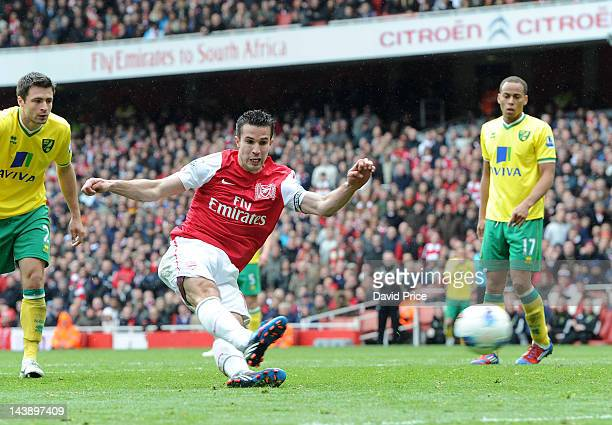 Robin van Persie scores his second goal during Barclays Premier League match between Arsenal and Norwich City at Emirates Stadium on May 5 2012 in...