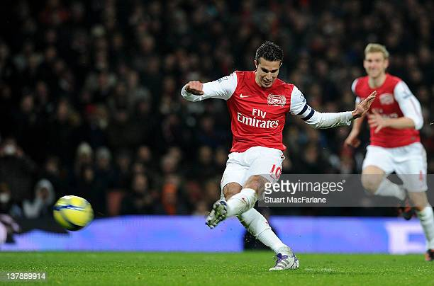 Robin van Persie shoots past Aston Villa keeper Shay Given to score his 2nd and Arsenal's 3rd goal during the FA Cup Fourth Round match between...
