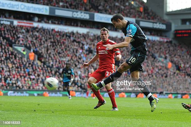 Robin van Persie shoots past Liverpool goalkeeper Pepe Renia to score the 2nd Arsenal goal during the Barclays Premier League match between Liverpool...