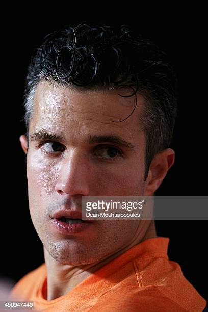 Robin van Persie speaks to the media during the Netherlands Press Conference at the 2014 FIFA World Cup Brazil held at the Estadio Jose Bastos...
