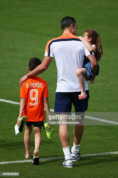 Robin van Persie walks with his daughter Dina Layla and son Shaqueel during the Netherlands training session at the 2014 FIFA World Cup Brazil held...