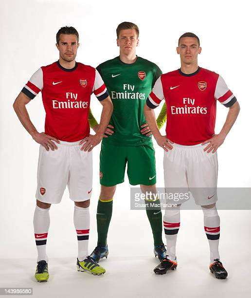 Robin van Persie Wojciech Szczesny and Thomas Vermaelen pose during a photoshoot for the new Arsenal home kit for season 2012/13 at London Colney on...