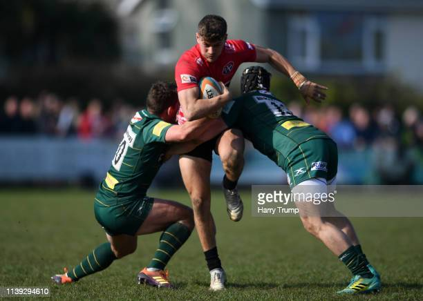 Robin Wedlake of Cornish Pirates is tackled by Ian Keatley and Tom Stephenson of Cornish Pirates during the Greene King IPA Championship match...