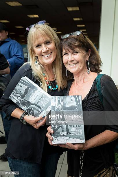 Robin Widner and Joni Lampro display their signed copies of the Bruce Springsteen book at the Bruce Springsteen fant event for Born To Run at Barnes...