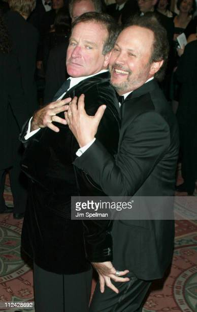 Robin Williams and Billy Crystal playing around during American Museum of the Moving Image Salutes Billy Crystal at The Waldorf Astoria in New York...
