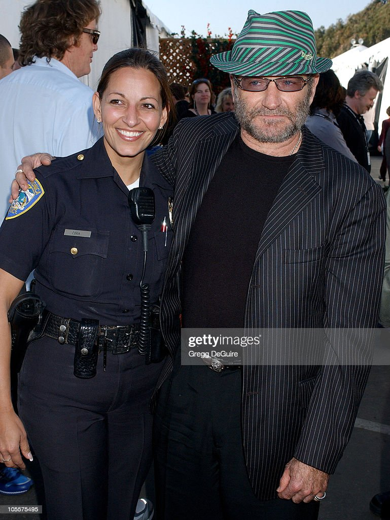 Robin Williams and Santa Monica Police officer during The 20th Annual IFP Independent Spirit Awards - Backstage in Santa Monica, California, United States.