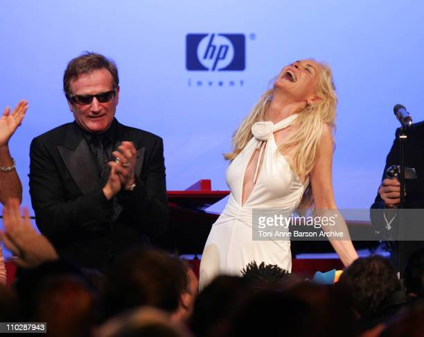 Robin Williams and Sharon Stone during amfAR's Cinema Against AIDS Benefit in Cannes, Presented by Bold Films, Palisades Pictures and The Weinstein...