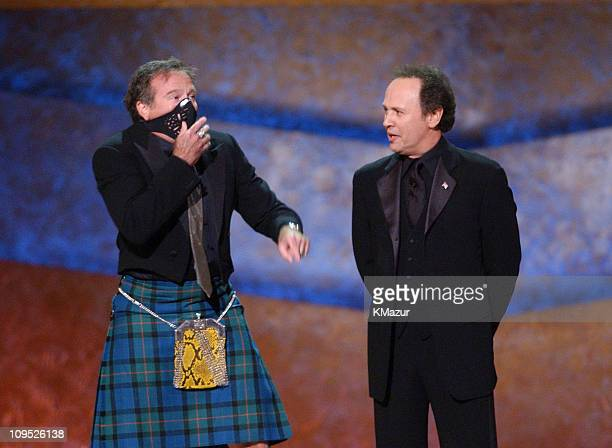 """Robin Williams appears on stage with gas mask with Billy Crystal; """"On Stage at the Kennedy Center: The Mark Twain Prize"""" will air November 21, at 9..."""