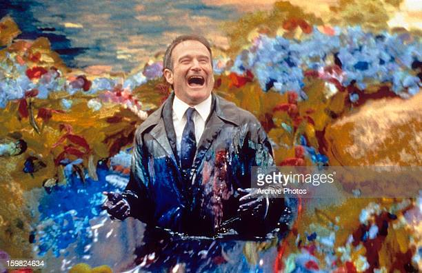Robin Williams is covered in paint in a scene from the film 'What Dreams May Come', 1998.
