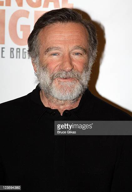 Robin Williams poses at the Bengal Tiger at the Baghdad Zoo Broadway cast photo call at The New 42nd Street Studios on February 16 2011 in New York...