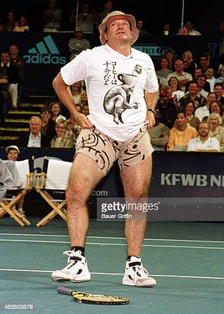 Robin Williams pulls his shorts up for the crowd at a Hollywood doubles tennis match between Himself Billy Crystal Pete Sampras and Andre Agassi on...