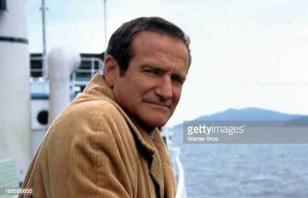 Robin Williams rides a boat in a scene from the film 'Insomnia', 2002.