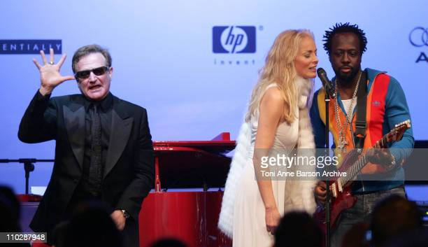 Robin Williams, Sharon Stone and Wyclef Jean during amfAR's Cinema Against AIDS Benefit in Cannes, Presented by Bold Films, Palisades Pictures and...