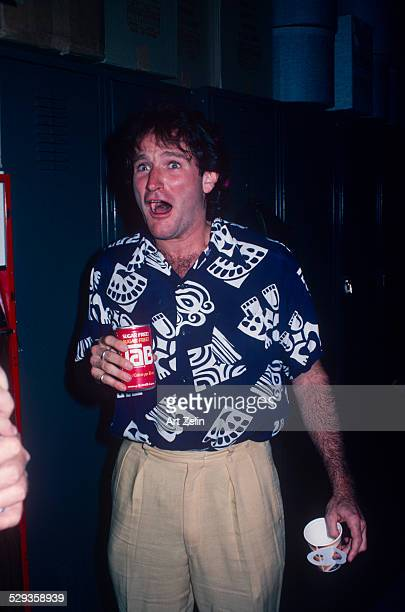 Robin Williams with a Tab, wearing a blue and white print shirt; circa 1970; New York.