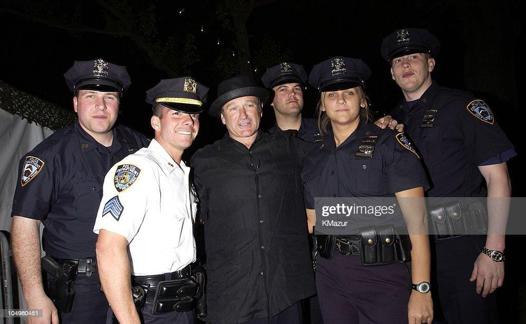 Robin Williams with New York City police officers during MTV's Rock and Comedy Concert - Backstage at Battery Park in New York City, New York, United States.