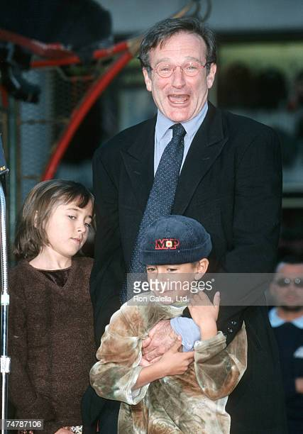 Robin Williams Zelda Williams and Cody Williams at the Mann's Chinese Theatre in Hollywood California
