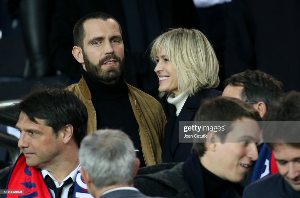 Robin Wright and Clement Giraudet attend the UEFA Champions League Round of 16 Second Leg match between Paris Saint-Germain (PSG) and Real Madrid at Parc des Princes stadium on March 6, 2018 in Paris, France.