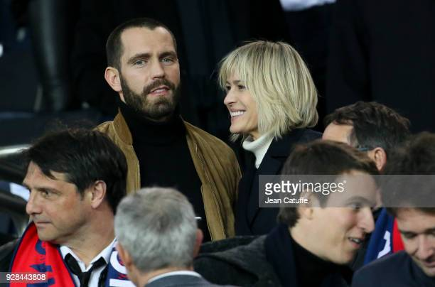 Robin Wright and Clement Giraudet attend the UEFA Champions League Round of 16 Second Leg match between Paris Saint-Germain and Real Madrid at Parc...