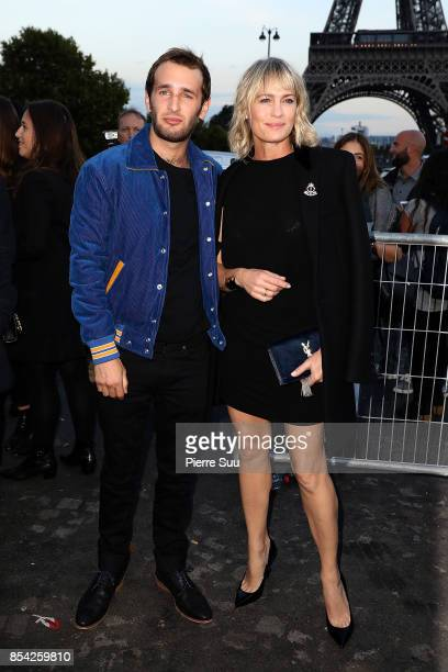 Robin Wright and Hopper Jack Penn arrive at the Saint Laurent show as part of the Paris Fashion Week Womenswear Spring/Summer 2018 on September 26...