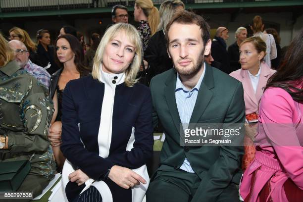 Robin Wright and Hopper Jack Penn attend the Valentino show as part of the Paris Fashion Week Womenswear Spring/Summer 2018 on October 1 2017 in...