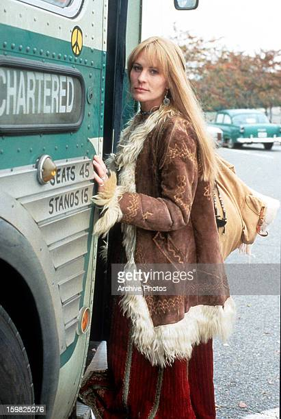 Robin Wright boards a bus in a scene from the film 'Forrest Gump', 1994.