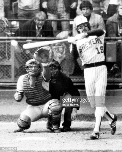Robin Yount of the Milwaukee Brewers checks his swing for a twoout two RBI single as catcher Darrell Porter of the St Louis Cardinals and umpire Dave...