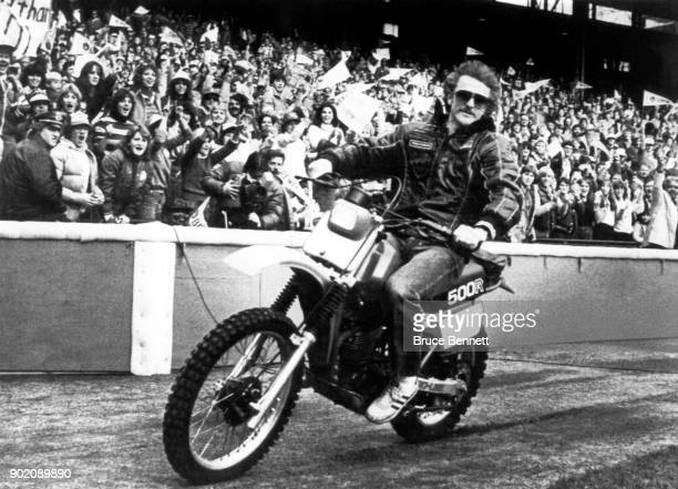 Robin Yount of the Milwaukee Brewers rides on his dirt bike around Milwaukee County Stadium after their parade as fans celebrate the Brewers World...