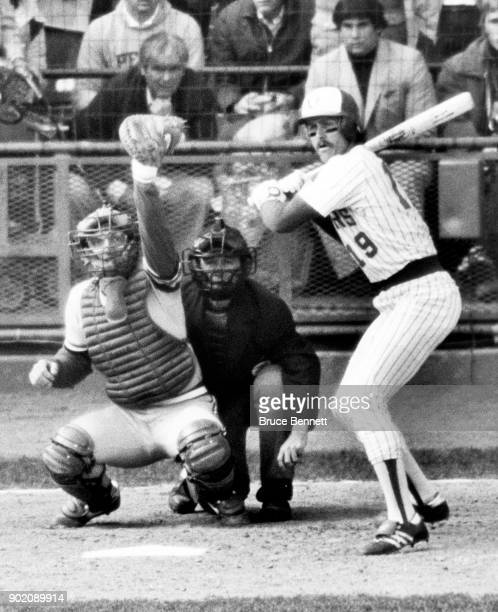 Robin Yount of the Milwaukee Brewers takes the pitch as catcher Darrell Porter of the St Louis Cardinals and umpire Dave Phillips look on during Game...