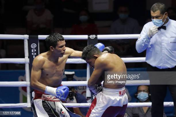 Robin Zamora throws a jab to Ramiro Blanco in the lightweight category during the main fight of the night at Alexis Arguello Sports Center on April...