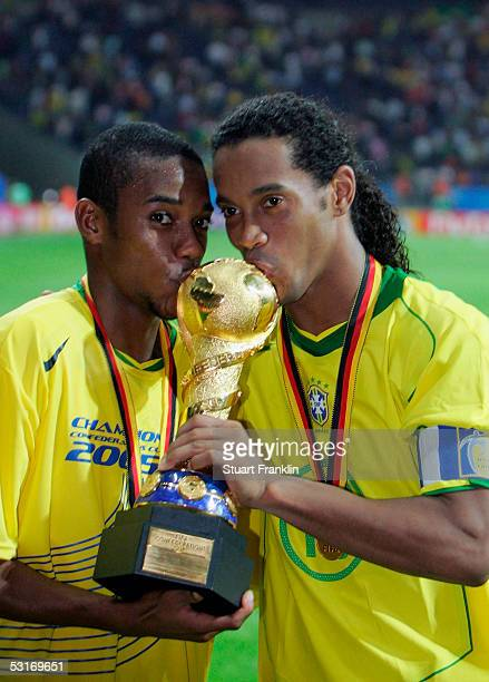 Robinho and Ronaldinho of Brazil kiss the the trophy following the FIFA 2005 Confederations Cup Final between Brazil and Argentina at the Waldstadion...