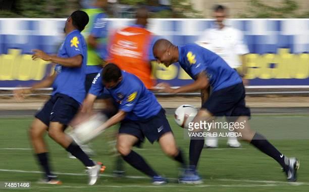 Robinho Elano and Afonso of the Brazilian national football team take part in a training session in Puerto de La Cruz Venezuela on June 21st 2007...