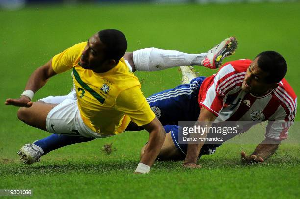 Robinho is tackled during a match between Brazil and Paraguay as part the Copa America 2011at the Only Stadium on July 172011 in Buenos AiresArgentina