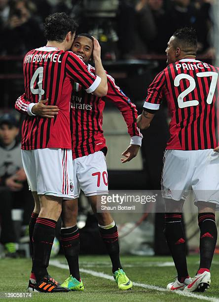 Robinho of AC Milan celebrates his second goal with team mates Mark van Bommel and KevinPrince Boateng during the UEFA Champions League round of 16...
