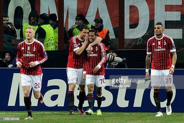Robinho of AC Milan celebrates scoring the third goal during the UEFA Champions League round of 16 first leg match between AC Milan and Arsenal FC at...