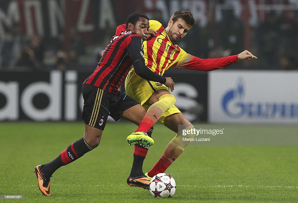 Robinho of AC Milan competes for the ball with Gerard Pique of FC Barcelona during the UEFA Champions League Group H match between AC Milan and FC Barcelona at Stadio Giuseppe Meazza on October 22, 2013 in Milan, Italy.