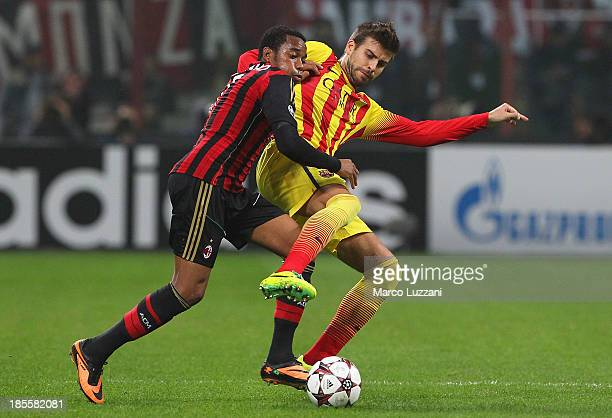 Robinho of AC Milan competes for the ball with Gerard Pique of FC Barcelona during the UEFA Champions League Group H match between AC Milan and FC...