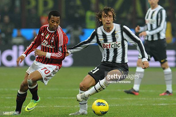 Robinho of AC Milan competes with Andrea Pirlo of Juventus FC during the Serie A match between AC Milan and Juventus FC at Stadio Giuseppe Meazza on...