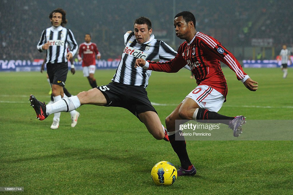 Robinho (R) of AC Milan in action against Andrea Barzagli of Juventus FC during the Serie A match between AC Milan and Juventus FC at Stadio Giuseppe Meazza on February 25, 2012 in Milan, Italy.