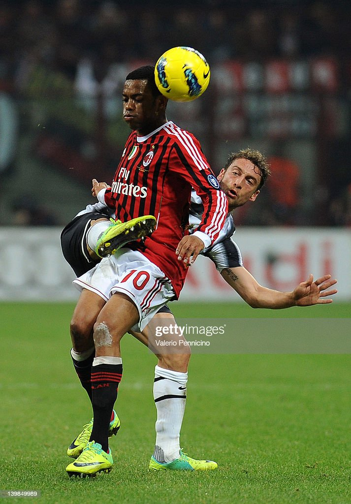 Robinho (L) of AC Milan is challenged by Claudio Marchisio of Juventus FC during the Serie A match between AC Milan and Juventus FC at Stadio Giuseppe Meazza on February 25, 2012 in Milan, Italy.