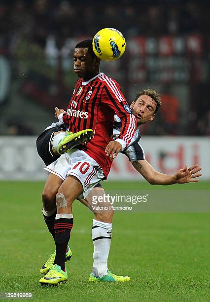 Robinho of AC Milan is challenged by Claudio Marchisio of Juventus FC during the Serie A match between AC Milan and Juventus FC at Stadio Giuseppe...