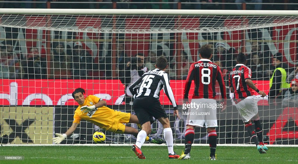 Robinho (R) of AC Milan scores the opening goal from the penalty spot during the Serie A match between AC Milan and Juventus FC at San Siro Stadium on November 25, 2012 in Milan, Italy.