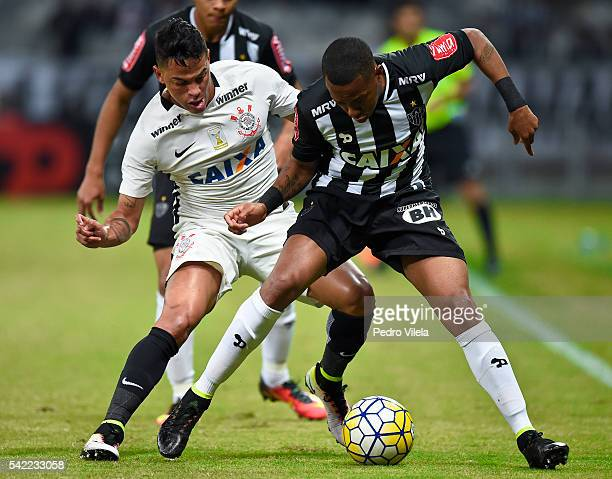 Robinho of Atletico MG and Giovanni Augusto of Corinthians battle for the ball during a match between Atletico MG and Corinthians as part of...