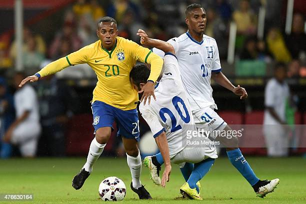 Robinho of Brazil and Alfredo Mejía and Beckeles of Honduras compete for the ball during the International Friendly Match between Brazil and Honduras...